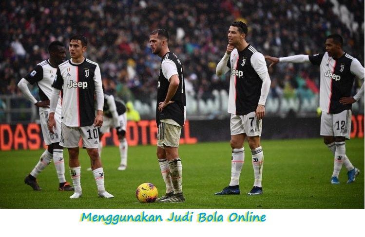 Menggunakan Judi Bola Online